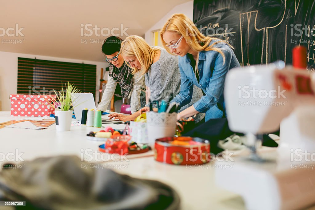 Fashion Designers Working In Their Workshop stock photo