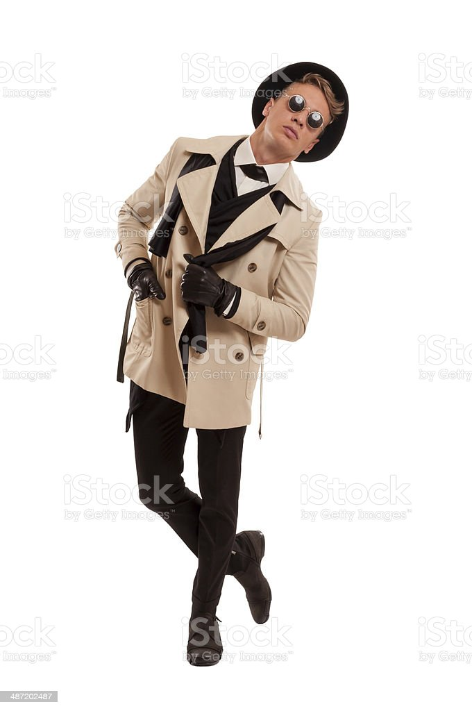 Fashion detective undercover posing on a white background royalty-free stock photo