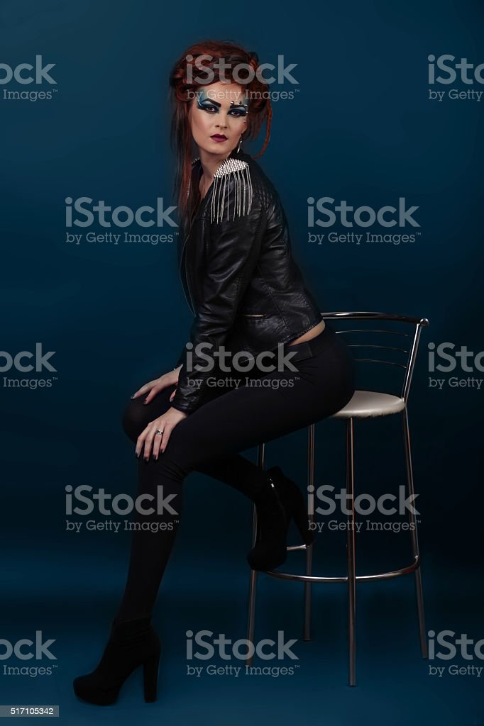 Fashion Dressed Sexy Girl Sitting on Chair. Full length Portrait royalty-free stock photo