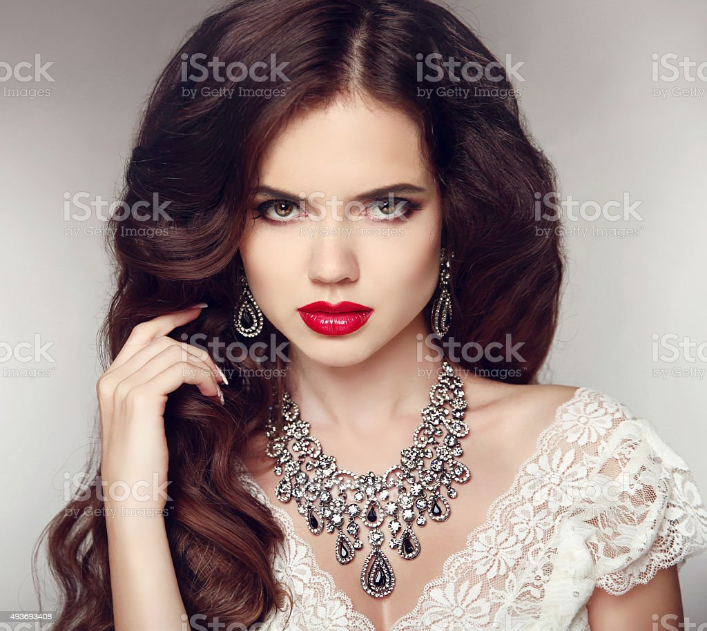 Fashion earrings and Necklace. Beauty girl portrait. Hairstyle. stock photo