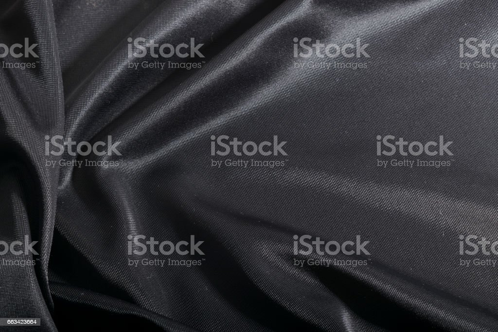 Fashion elegant dark fabric, black textile background. stock photo