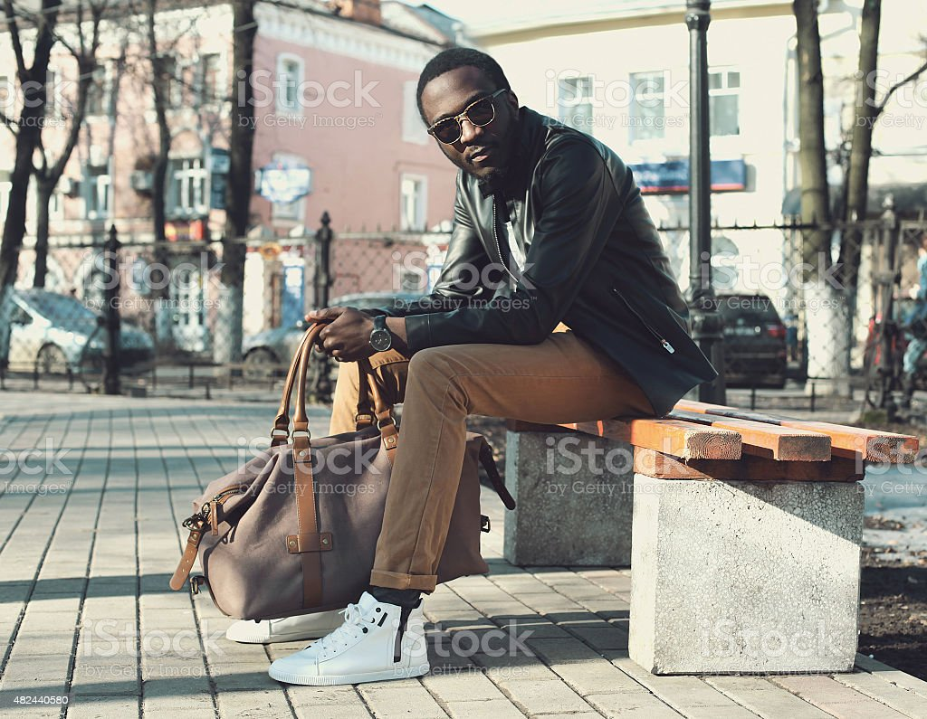 Fashion elegant young african man wearing a sunglasses and black stock photo