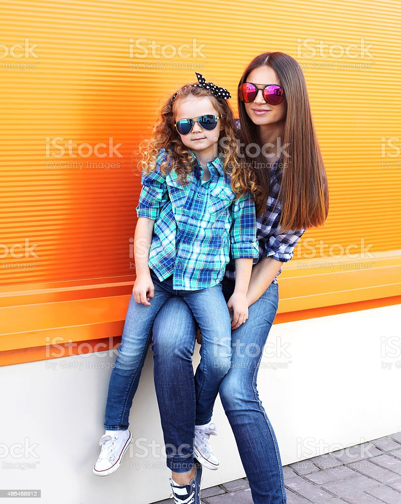 Fashion family concept - mother and child stock photo