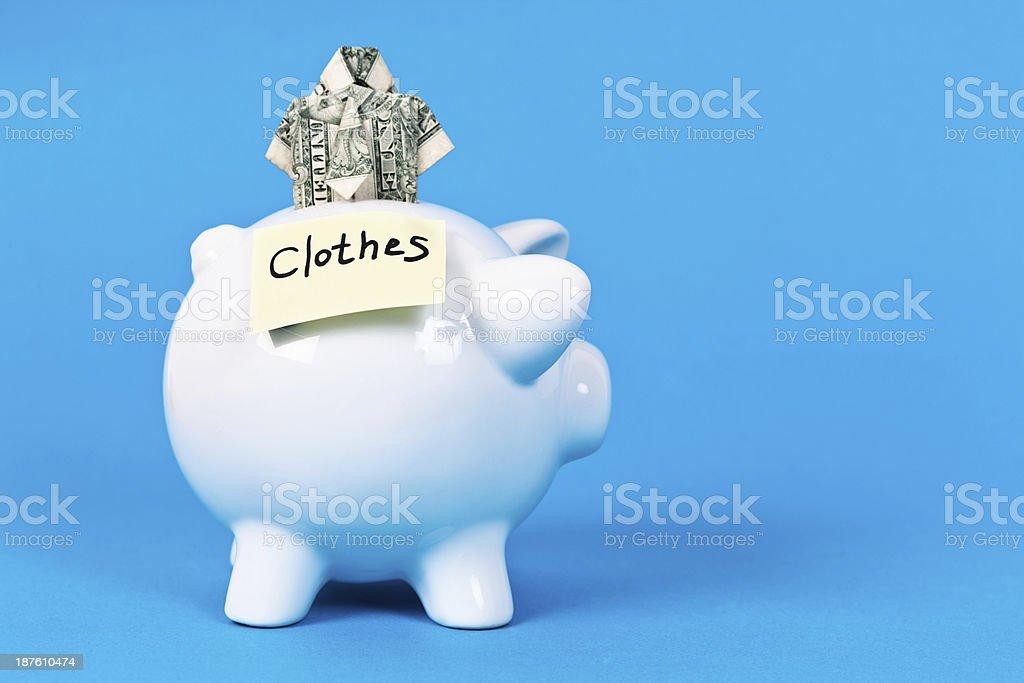 Fashion fan targets clothes saving with tiny origami-money shirt royalty-free stock photo