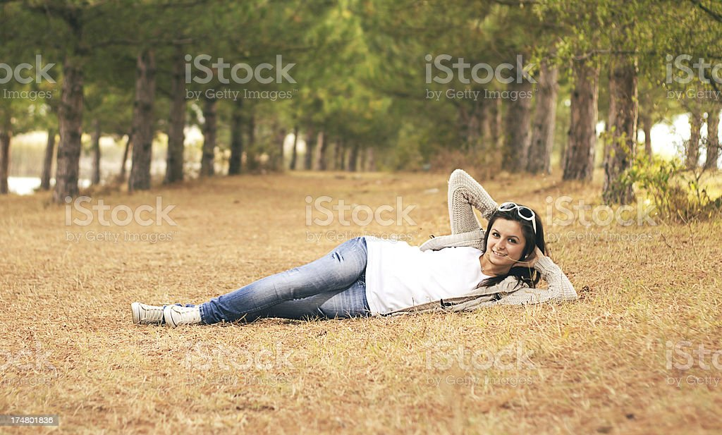 Fashion girl enjoying in the park at autumn royalty-free stock photo