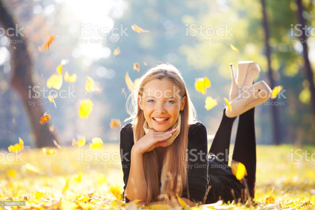 Fashion girl enjoying in the park royalty-free stock photo