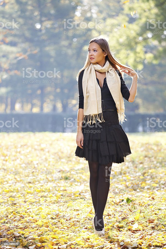 Fashion girl walking in the park royalty-free stock photo