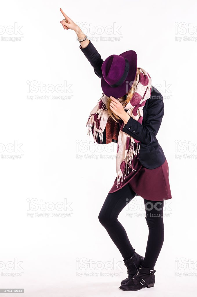 Fashion Girl With Hat in Dance Pose stock photo