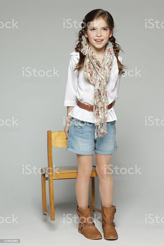 Fashion girl with wooden chair royalty-free stock photo