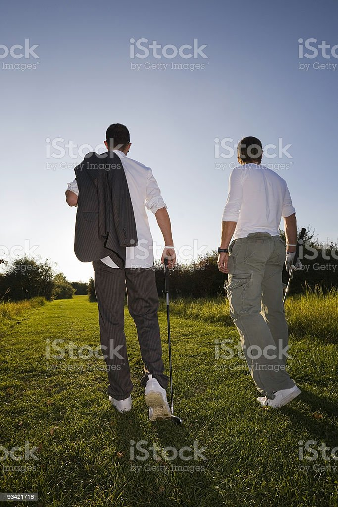 Fashion Golf Players on their Way to the Clubhouse royalty-free stock photo