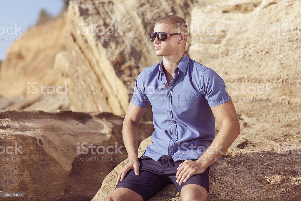 fashion guy on the beach royalty-free stock photo