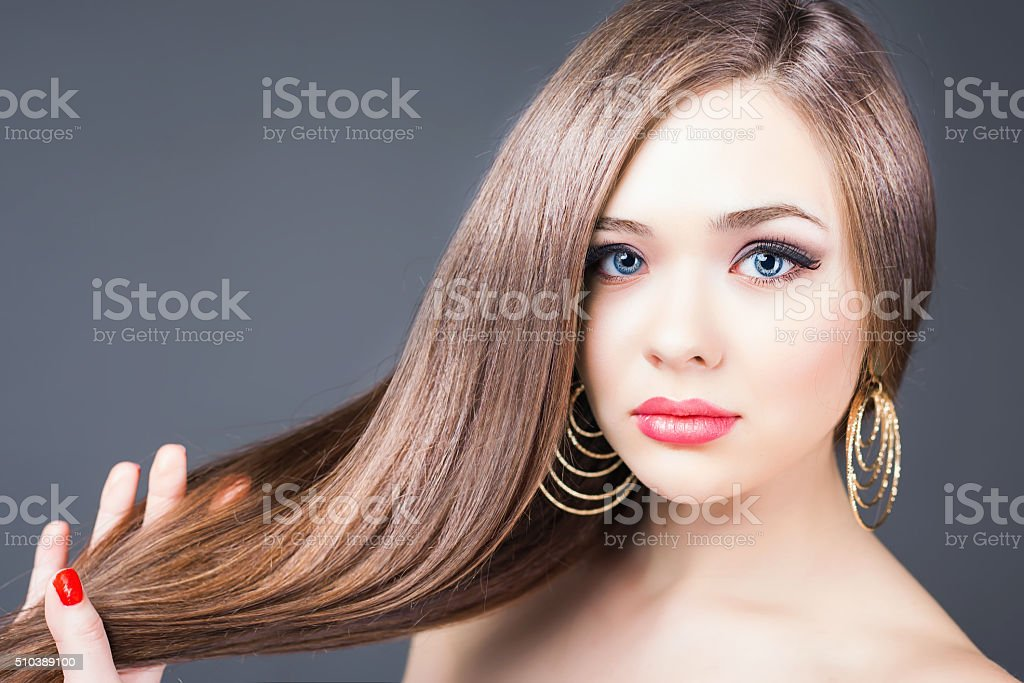 Fashion hairstyle. Beautiful woman with long straight hair stock photo