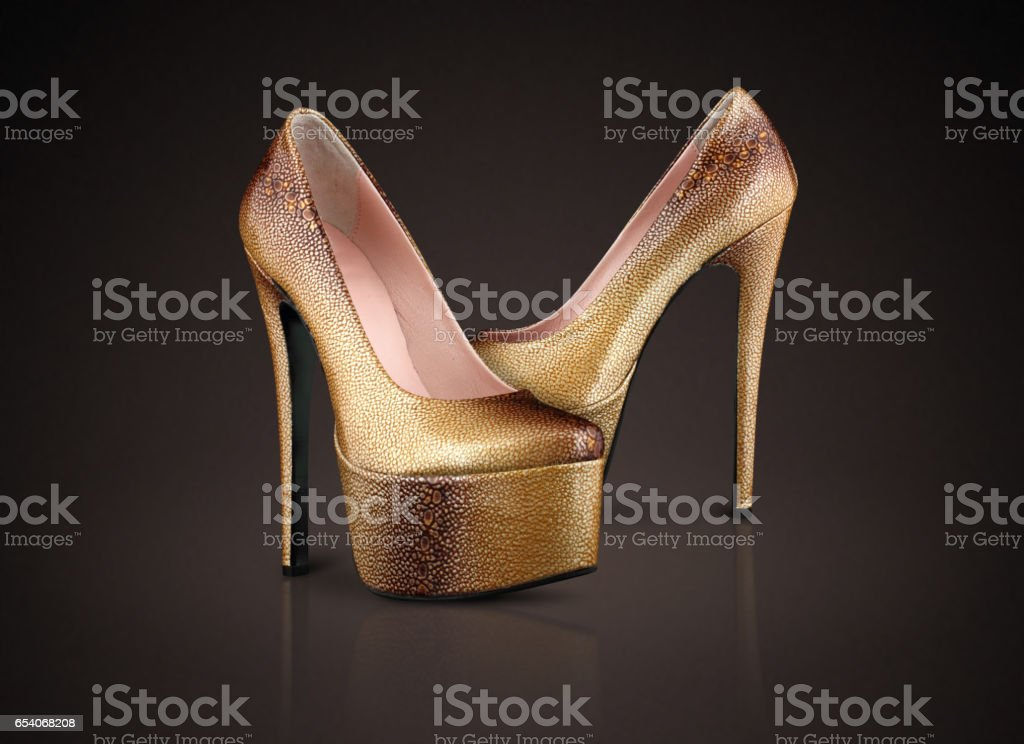 Fashion high heels shoes on chocolate background stock photo
