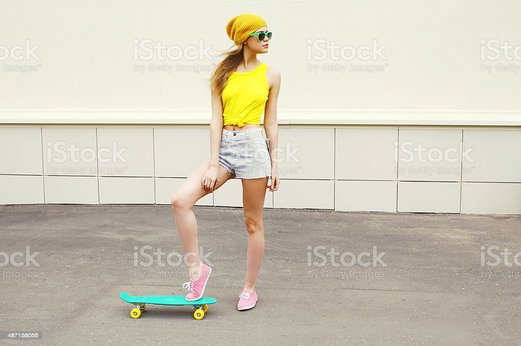 Fashion hipster cool woman wearing a sunglasses and colorful yel stock photo