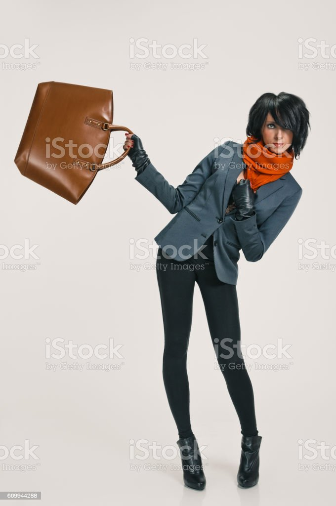 Fashion lady equilibrations with bag stock photo