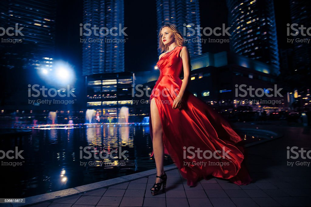 Fashion Lady In Red Dress And City Lights stock photo