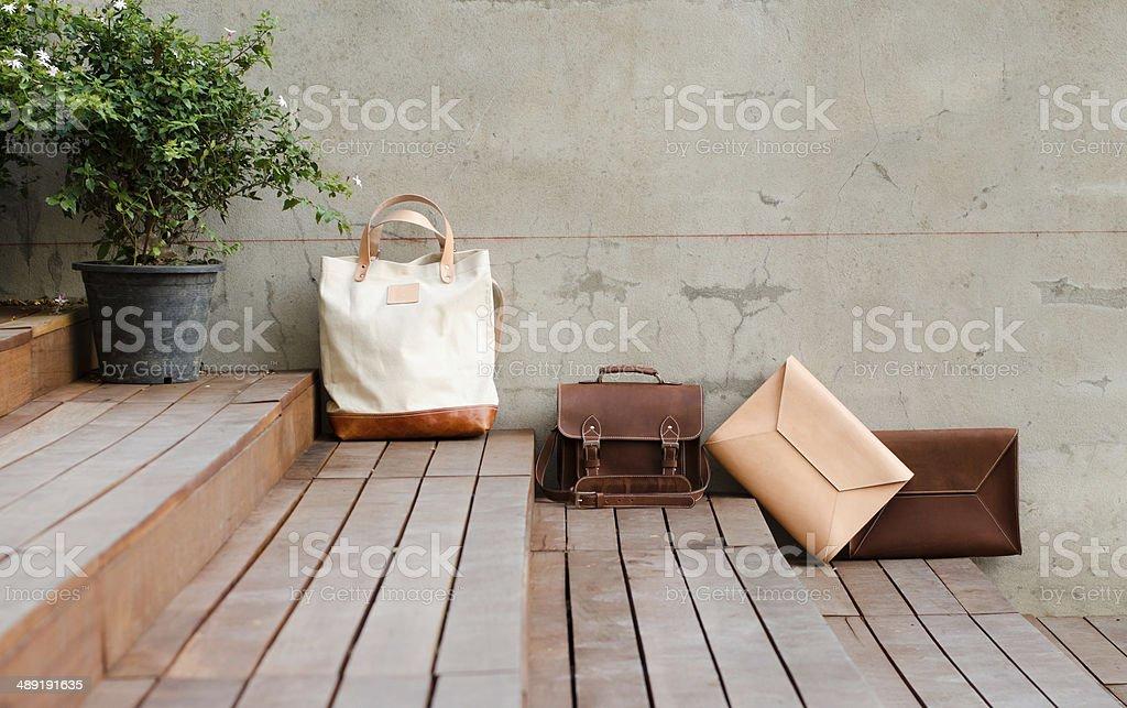Fashion Leather Bags on grunge background stock photo