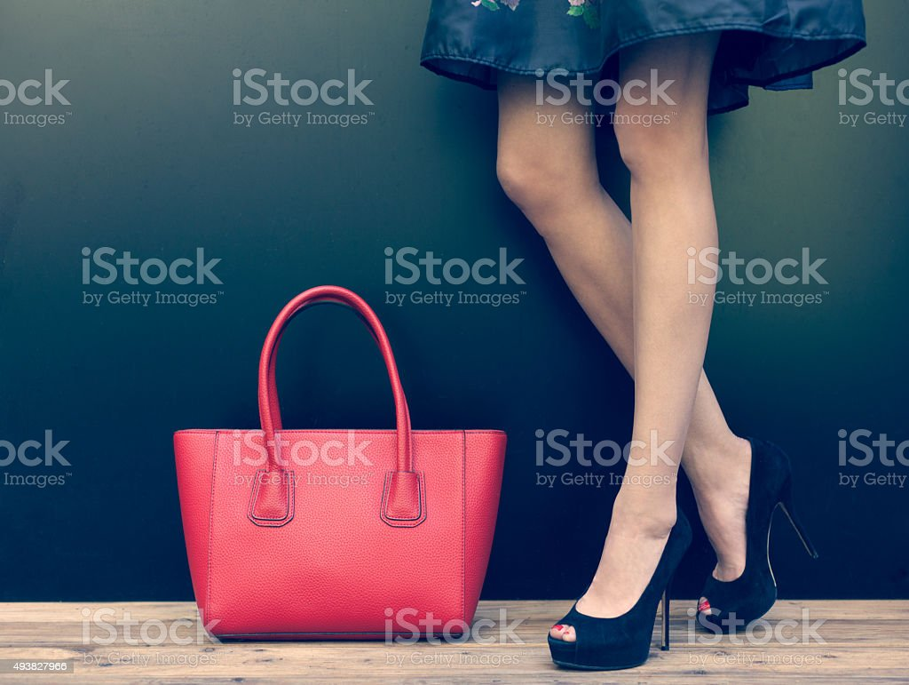 Fashion leggy girl in a high-heeled shoes in short dress stock photo