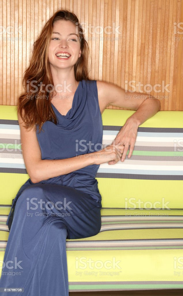 Fashion lifestye woman laughing portrait looking off camera stock photo