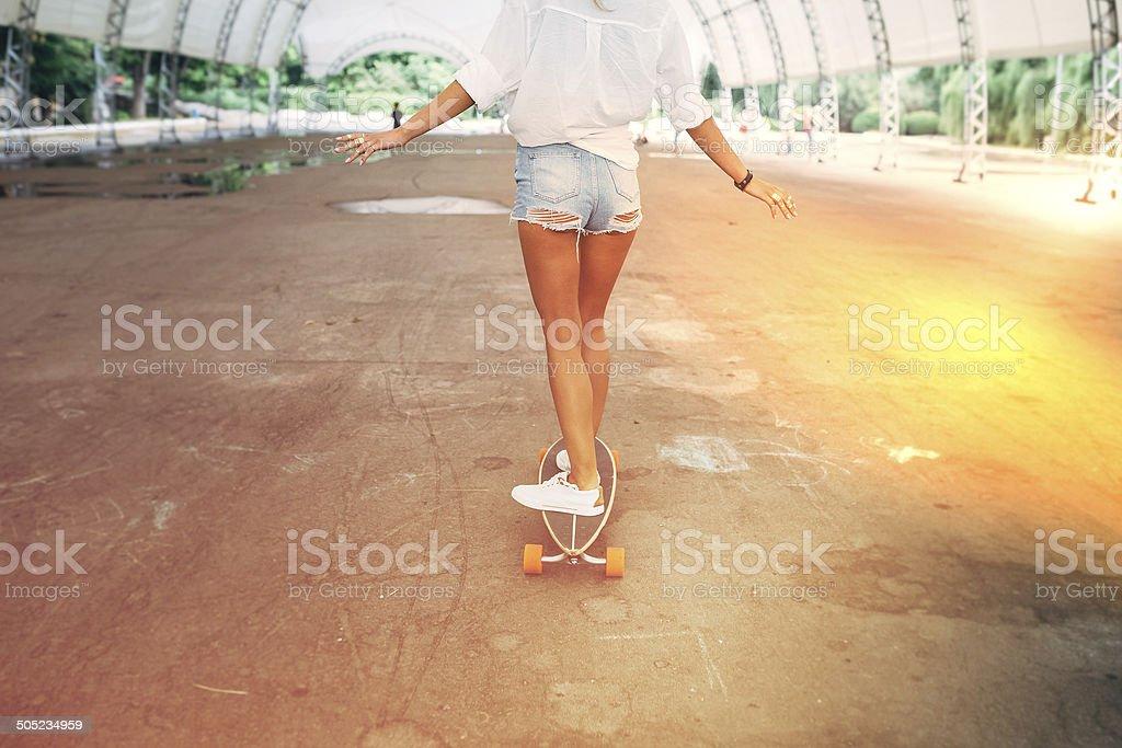 Fashion lifestyle, beautiful young woman with longboard stock photo