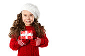 Fashion little girl with Christmas gift, isolated on white background