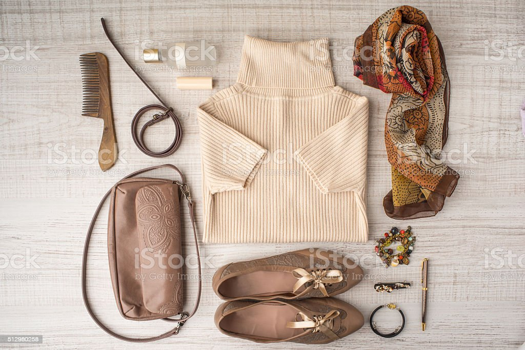 Fashion look set in beige colors top view stock photo
