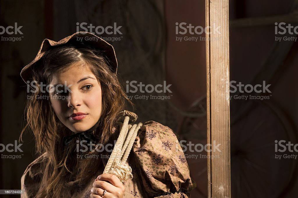 Fashion:  Lovely young woman in 1800's Western period dress. royalty-free stock photo