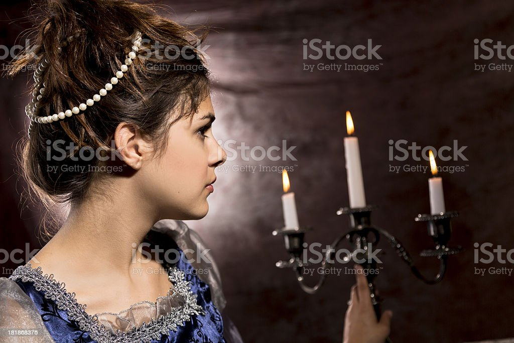Fashion:  Lovely young woman in renaissance period dress stock photo