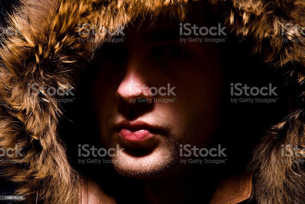 Fashion man in fur hood stock photo