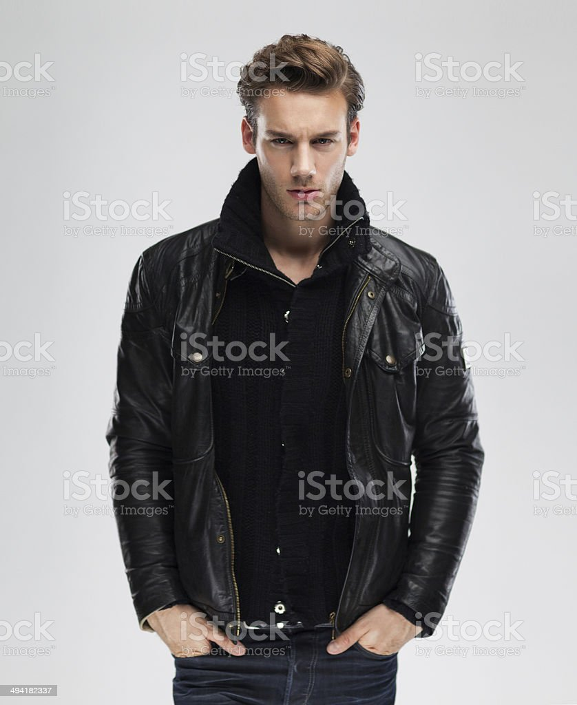 Fashion man, model leather jacket, gray background stock photo
