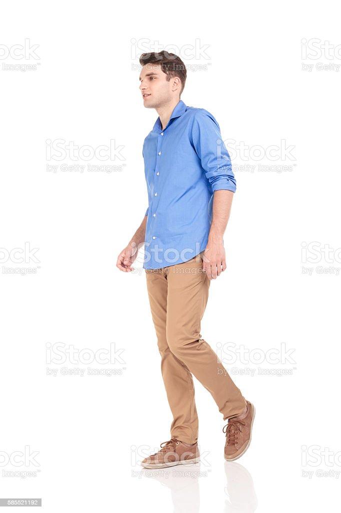 fashion man walking on isolated background. stock photo