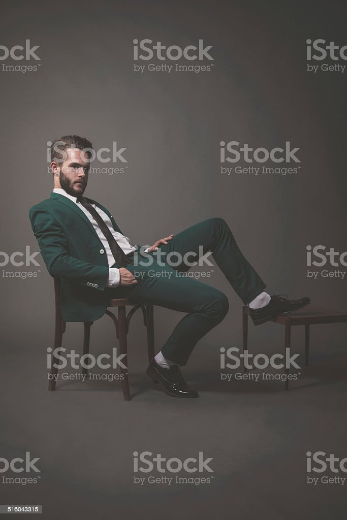 Fashion man wearing green suit with white shirt black a stock photo