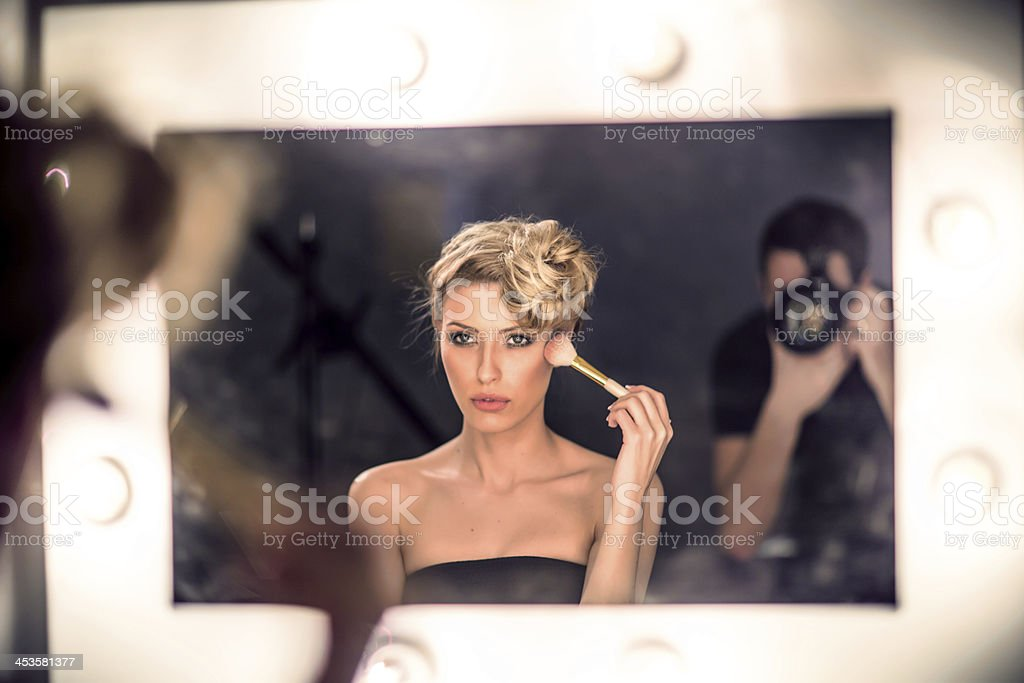 Fashion model and a photographer royalty-free stock photo