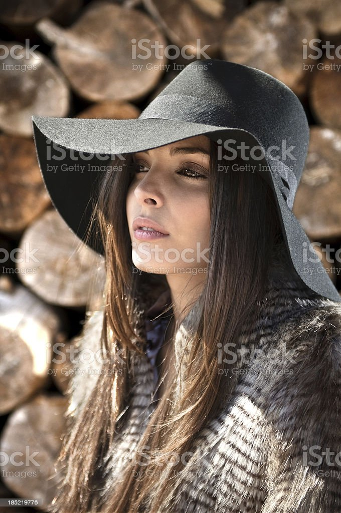 Fashion model dressed with coat and hat stock photo