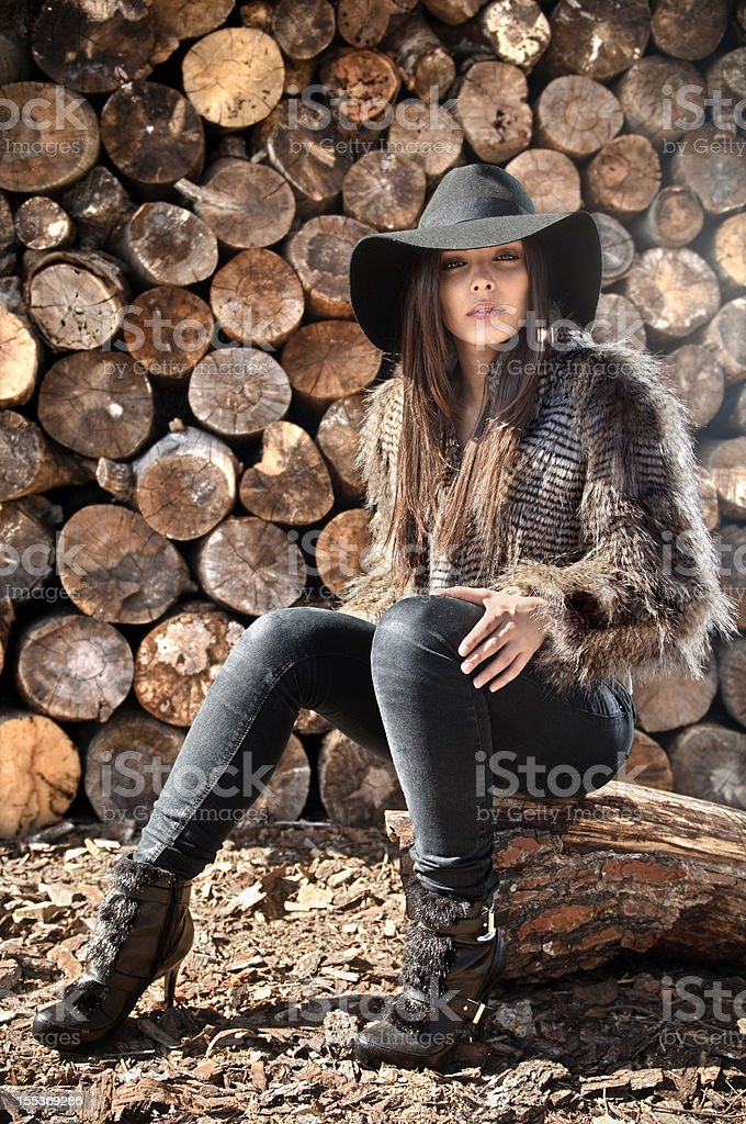 Fashion model dressed with coat and pants royalty-free stock photo