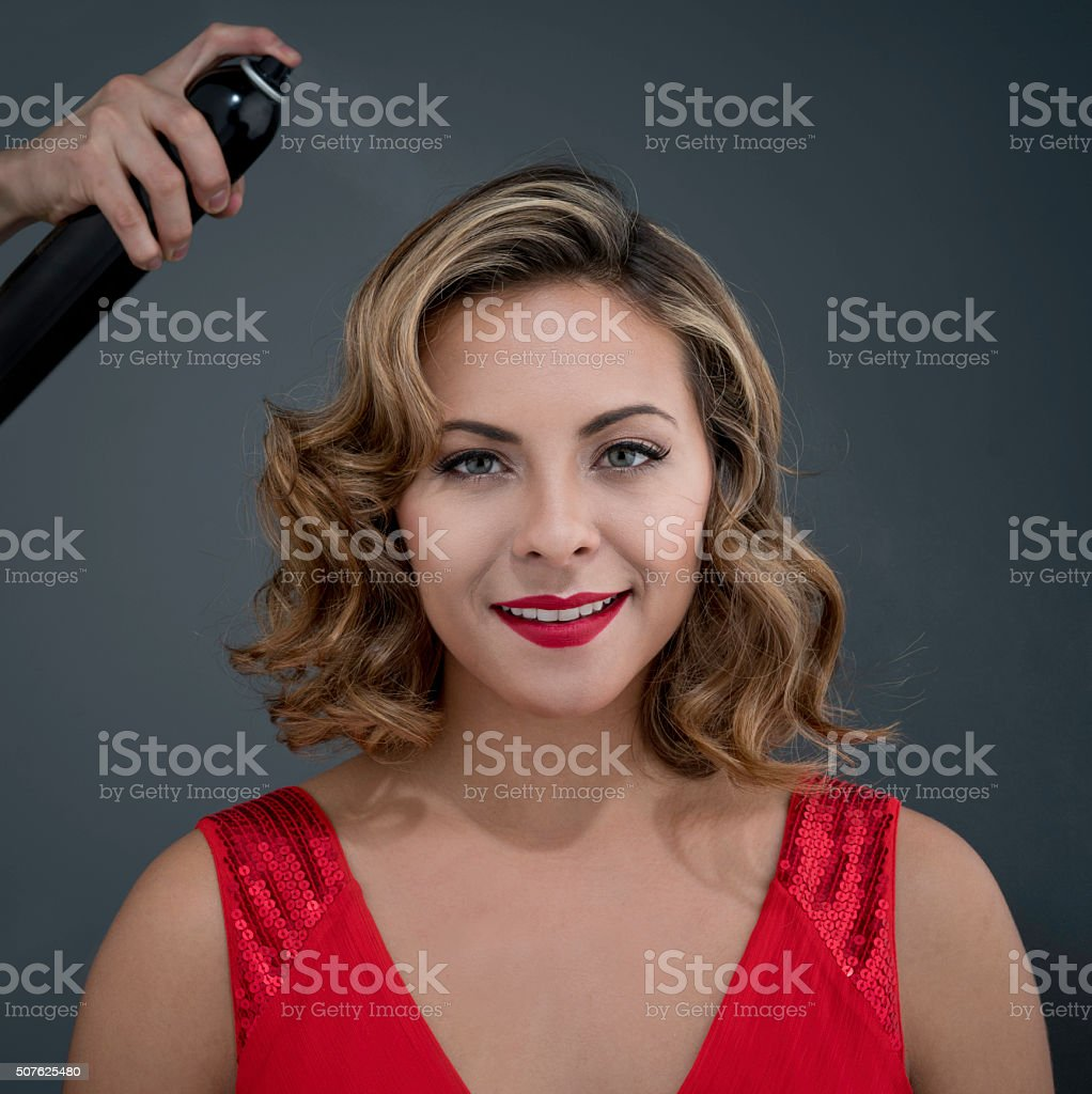 Fashion model getting her hair done stock photo