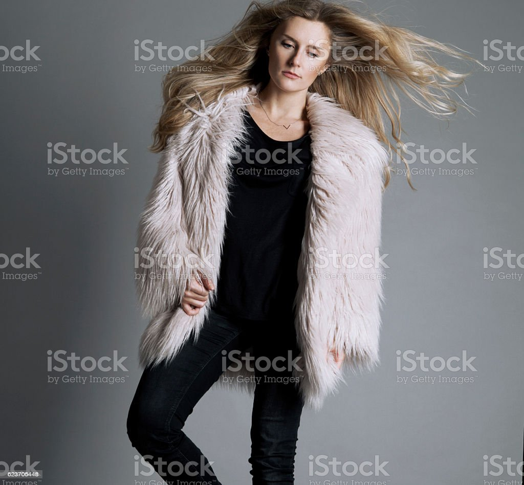 Fashion model in a pink fur coat stock photo