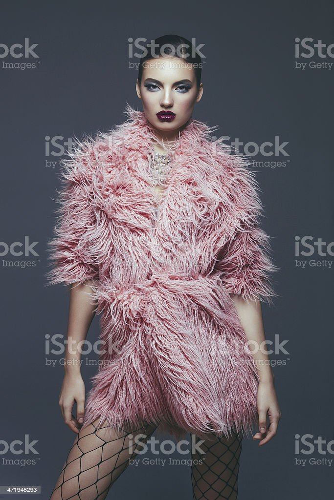Fashion model in fur coat stock photo