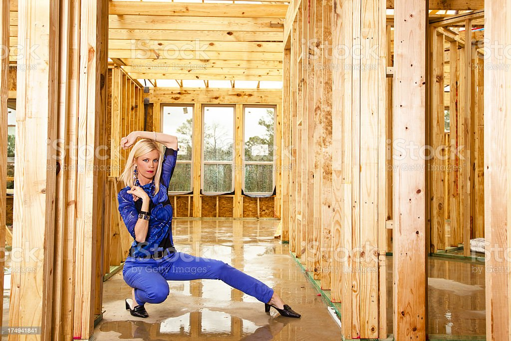 Fashion model in home hallway under construction royalty-free stock photo