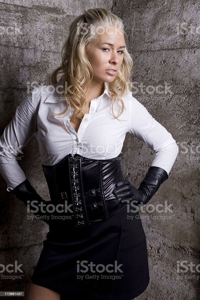 Fashion model in leather gloves, corset stock photo