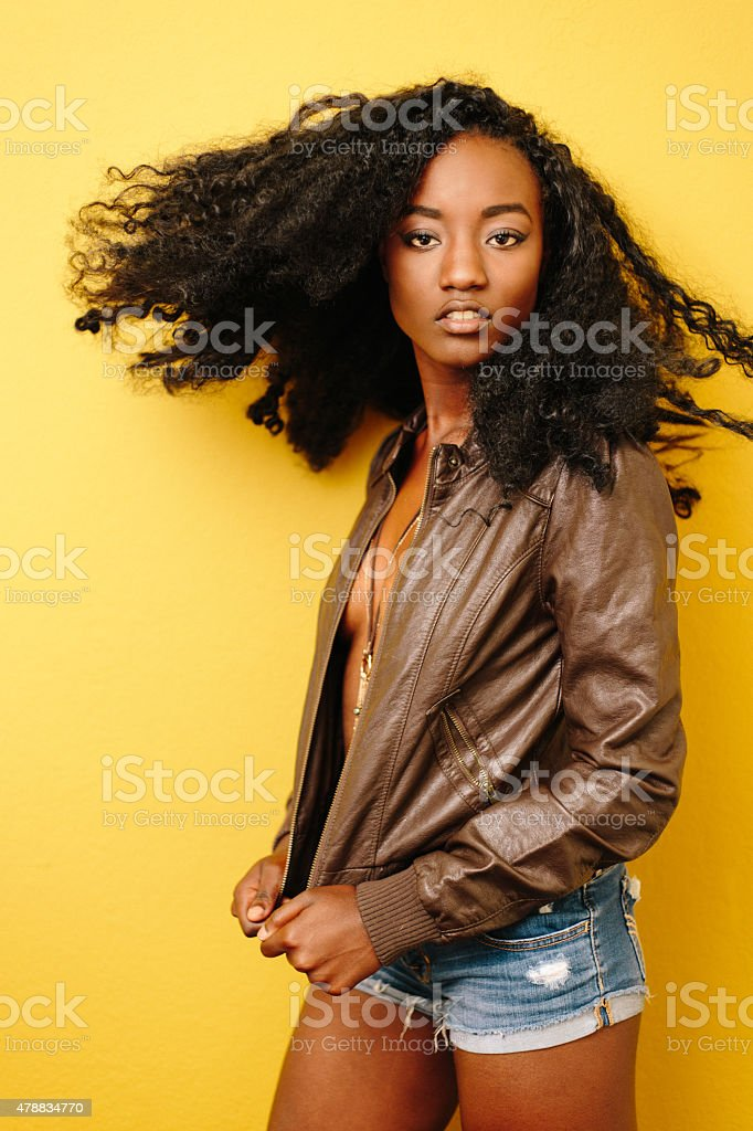 Fashion model in leather jacket and short jean shorts stock photo