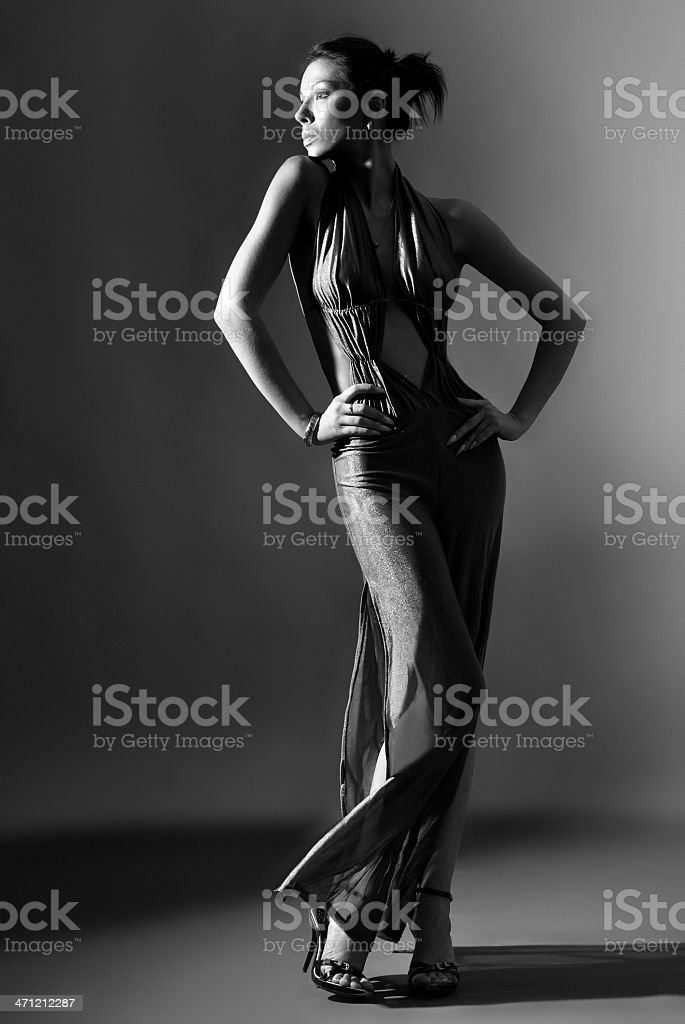 Fashion model in long clothes on dark background royalty-free stock photo