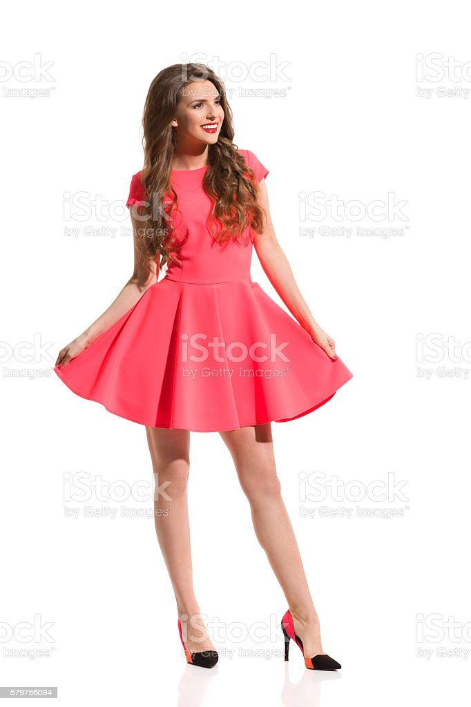 Fashion Model In Pink Mini Dress Isolated stock photo