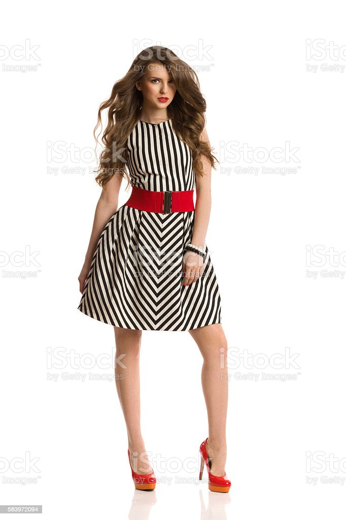 Fashion Model In Striped Dress And High Heels stock photo