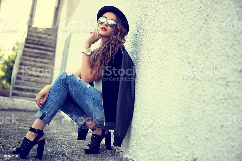 fashion model in sunglasses posing outdoor stock photo