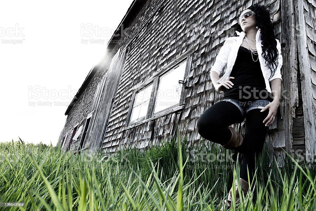 fashion model leaning on barn royalty-free stock photo