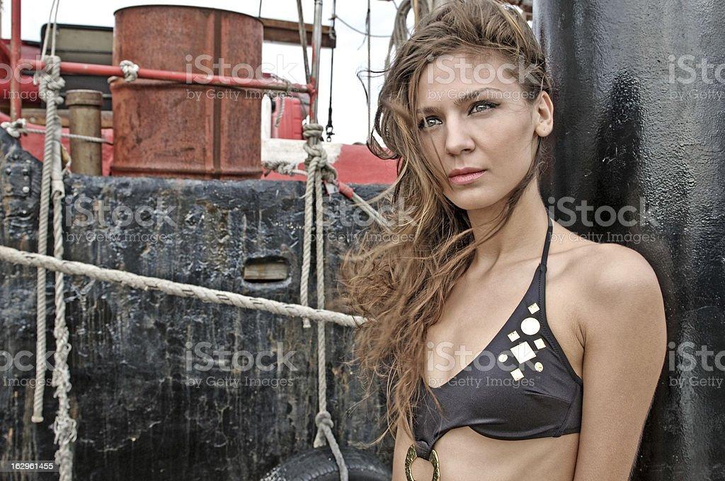 Fashion model next to a ship stock photo