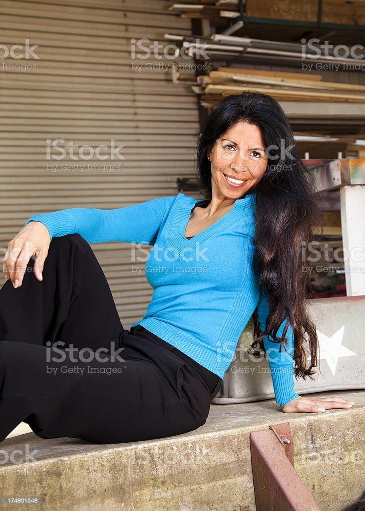 Fashion: model on ledge behind workshop royalty-free stock photo