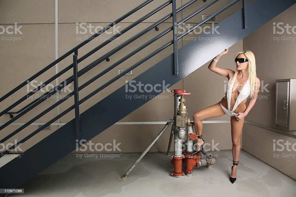 Fashion Model on Roof top deck with Exit stairs stock photo