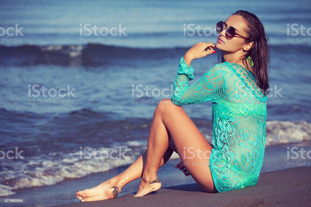 Fashion model on the beach stock photo